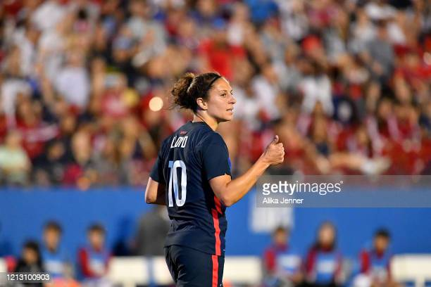 Carli Lloyd of the United States gives a thumbsup to her teammates during the second half of the SheBelieves Cup match against Japan at Toyota...