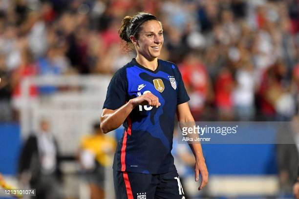 Carli Lloyd of the United States is all smiles after the SheBelieves Cup match victory over Japan at Toyota Stadium on March 11 2020 in Frisco Texas...