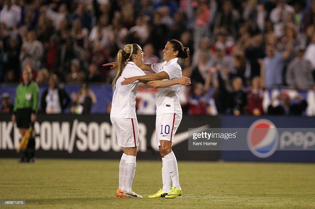 Carli Lloyd #10 of the United States is congratulated after scoring a goal by teammate Morgan Brian #7 in the first half of the game against China during an international firendly match at Qualcomm Stadium on April 10, 2014 in San Diego, California.