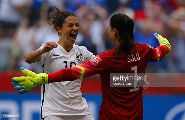 Carli Lloyd of the United States of America celebrates after her third goal against Japan with goalkeeper Hope Solo in the FIFA Women's World Cup...