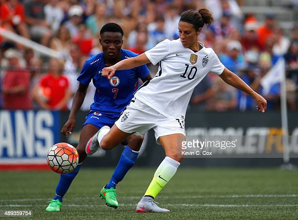 Carli Lloyd of the United States of America controls the ball against Roselord Borgella of Haiti during the US Women's 2015 World Cup victory tour...