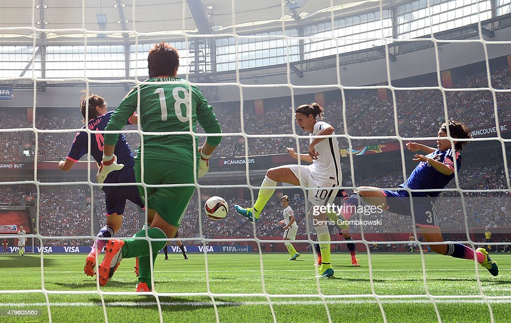 Carli Lloyd #10 of the United States of America scores the team's second goal against Saki Kumagai #4, Azusa Iwashimizu #3 and goalkeeper Ayumi Kaihori #18 of Japan in the FIFA Women's World Cup Canada 2015 Final at BC Place Stadium on July 5, 2015 in Vancouver, Canada.