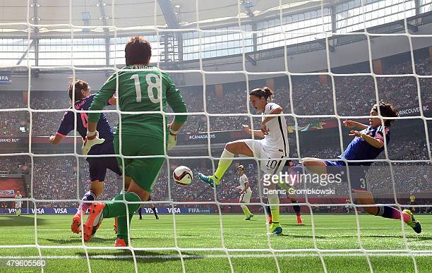 Carli Lloyd of the United States of America scores the team's second goal against Saki Kumagai, Azusa Iwashimizu and goalkeeper Ayumi Kaihori of...