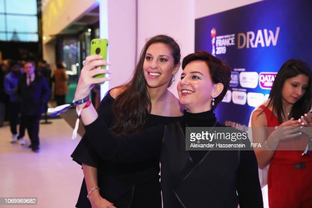Carli Lloyd of the United States poses for a selfie prior to the FIFA Women's World Cup France 2019 Draw at La Seine Musicale on December 8 2018 in...