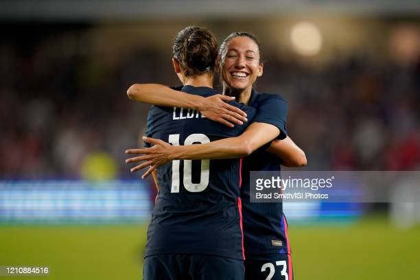 Carli Lloyd of the United States scores a goal and celebrates with Christen Press during a game between England and USWNT at Exploria Stadium on...