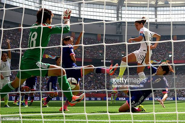 Carli Lloyd of the United States scores her second goal of the first half agaisnt goalkeeper Ayumi Kaihori of Japan in the FIFA Women's World Cup...