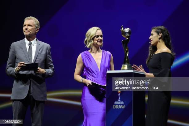 Carli Lloyd of the United States talks to draw hosts Amanda Davies and Denis Brogniart during the FIFA Women's World Cup France 2019 Draw at La Seine...