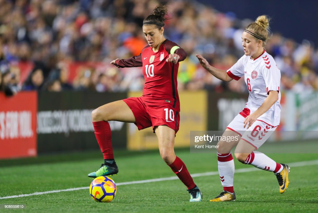 Carli Lloyd #10 of the U.S. women's national team dribbles the ball during the second half against Nanna Christiansen #6 of the Danish women's national team at SDCCU Stadium on January 21, 2018 in San Diego, California.