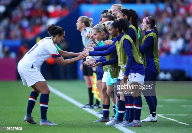 Carli Lloyd of the USA celebrates with teammates after scoring her team's first goal during the 2019 FIFA Women's World Cup France group F match...