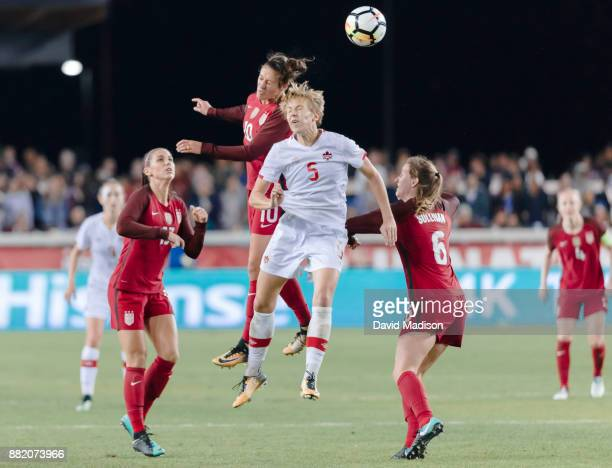 Carli Lloyd of the USA contests a head ball against Rebecca Quinn of Canada during an international friendly match played on November 12 2017 at...