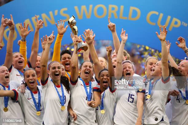 Carli Lloyd of the USA lifts the FIFA Women's World Cup Trophy following her team's victory in the 2019 FIFA Women's World Cup France Final match...