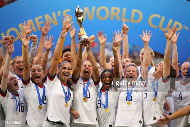 Carli Lloyd of the USA lifts the trophy as USA celebrate victory during the 2019 FIFA Women's World Cup France Final match between The United State...