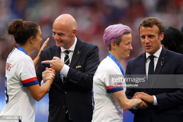 Carli Lloyd of the USA shakes hands with Gianni Infantino President of FIFA whilst Megan Rapinoe of the USA shakes hands with Emmanuel Macron...