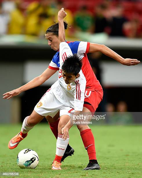 Carli Lloyd of the USA struggles for the ball with Ren Guixin of China during a match between USA and China as part of International Women's Football...