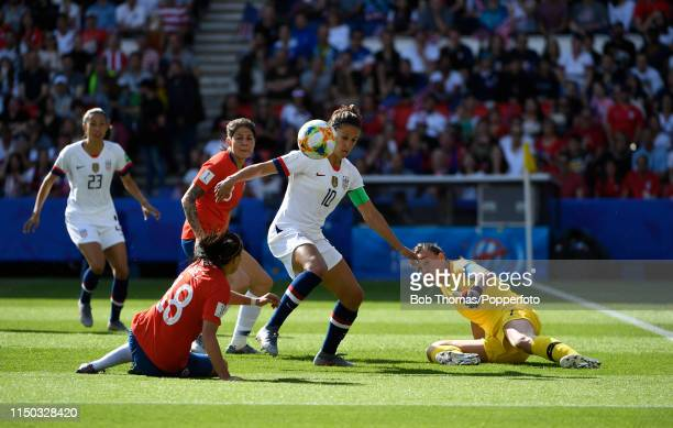 Carli Lloyd of the USA with Camila Saez and goalkeeper Christiane Endler of Chile during the 2019 FIFA Women's World Cup France group F match between...