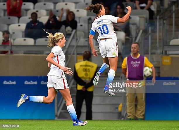 Carli Lloyd of United States and Allie Long of United States celebrate after Lloyd scores in the first half in the Women's Group G first round match...