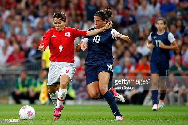 Carli Lloyd of United States and Nahomi Kawasumi of Japan battle for the ball in the first half during the Women's Football gold medal match on Day...