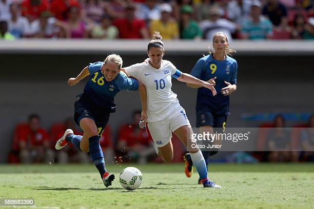 Carli Lloyd of United States battles for the ball against Elin Rubensson of Sweden in the first half during the Women's Football Quarterfinal match...
