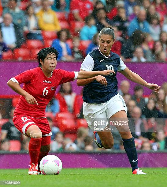 Carli Lloyd of United States battles with Choe Un Ju of DPR Korea during the Women's Football first round Group G match between the United States and...