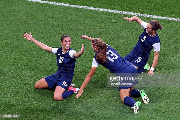 Carli Lloyd of United States celebrates her first half goal with teammates Alex Morgan and Kelley O'Hara against Japan during the Women's Football...