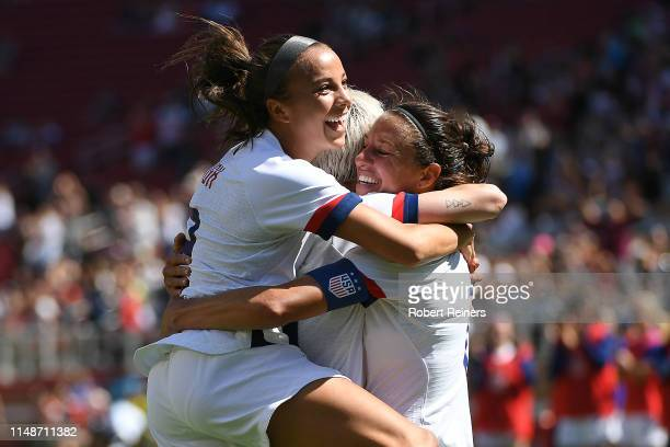 Carli Lloyd of United States celebrates her goal against South Africa with Megan Rapinoe and Mallory Pugh during their International Friendly at...