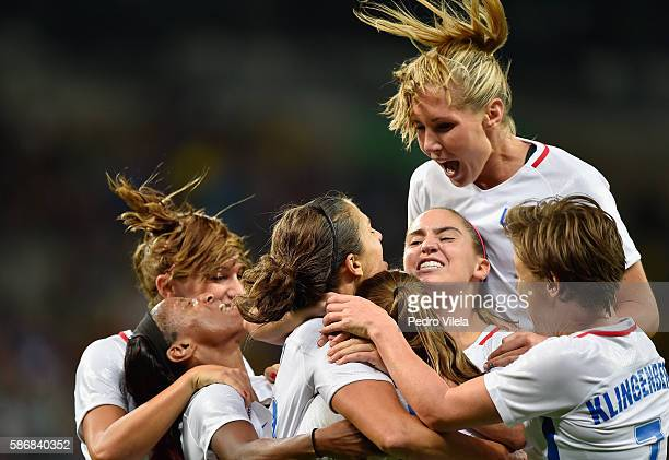 Carli Lloyd of United States celebrates with her team after scoring during the Women's Group G first round match between United States and France...
