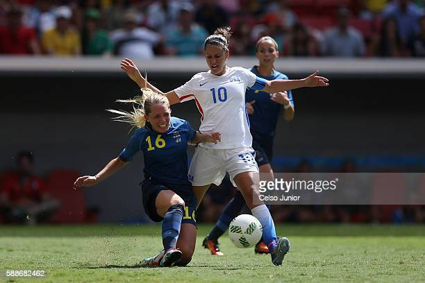 Carli Lloyd of United States controls the ball against Elin Rubensson of Sweden in the first half during the Women's Football Quarterfinal match at...