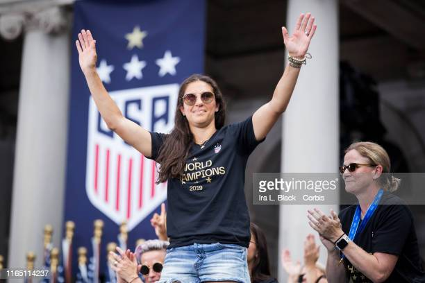 Carli Lloyd of United States holds her arms up as Jill Ellis Head Coach of the US Women's National Team claps during the ceremony on the steps of...