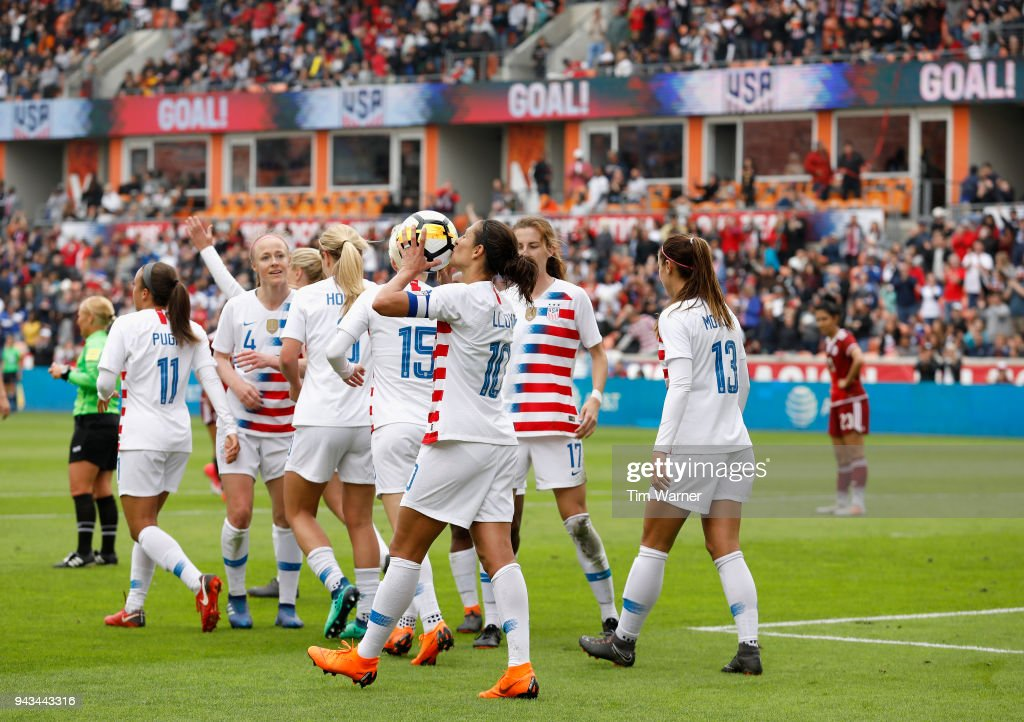 Carli Lloyd #10 of United States kisses the ball after scoring a goal in the first half against the Mexico at BBVA Compass Stadium on April 8, 2018 in Houston, Texas.