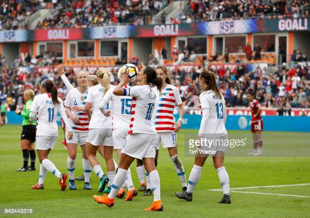 Carli Lloyd of United States kisses the ball after scoring a goal in the first half against the Mexico at BBVA Compass Stadium on April 8, 2018 in...