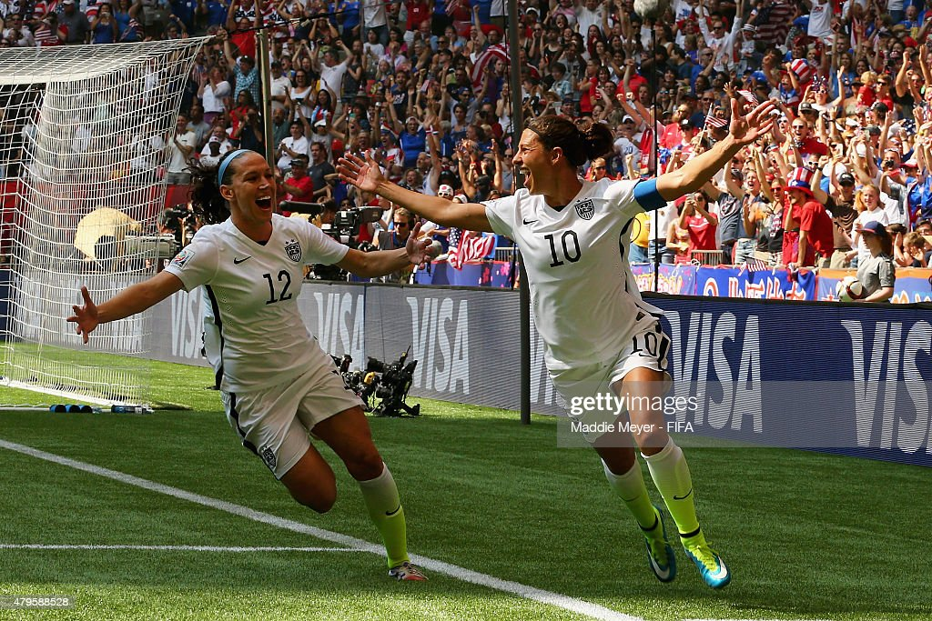 Carli Lloyd #10 of United States of America celebrates with Lauren Holiday #12 after scoring a goal during the FIFA Women's World Cup 2015 final match between USA and Japan at BC Place Stadium on July 5, 2015 in Vancouver, Canada.