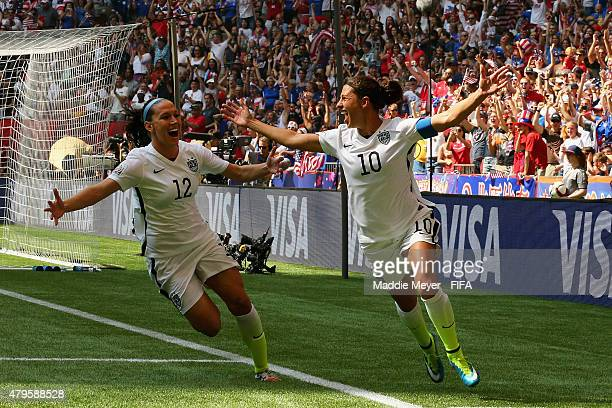 Carli Lloyd of United States of America celebrates with Lauren Holiday after scoring a goal during the FIFA Women's World Cup 2015 final match...