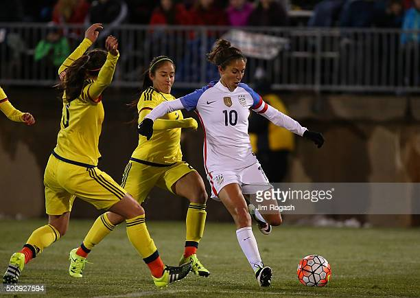 Carli Lloyd of United States of America works toward the net as Colombia players defend in the second half during an international friendly soccer...
