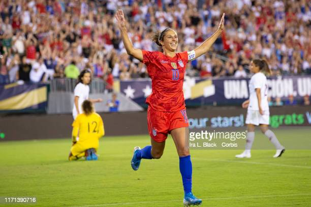 Carli Lloyd of United States of the U.S. Women's 2019 FIFA World Cup Championship flaps her arms like an Eagle as she celebrates soaring a goal in...