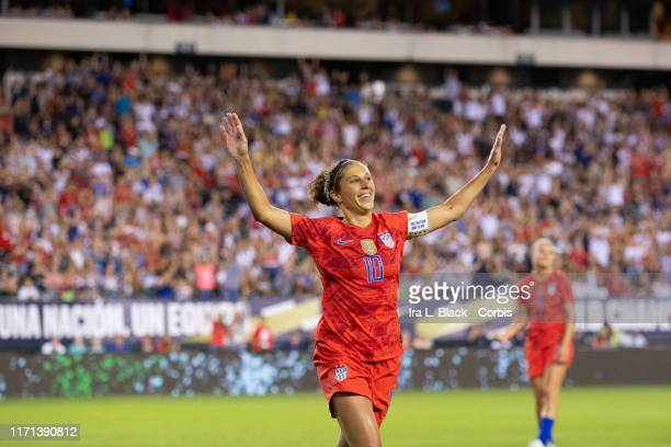 Carli Lloyd of United States of the US Women's 2019 FIFA World Cup Championship flaps her arms like an Eagle as she celebrates soaring a goal in the...