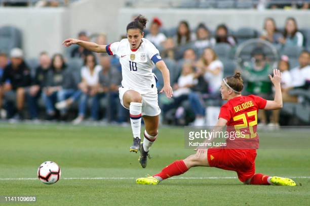 Carli Lloyd of United States Women's National Team jumps over Laura Deloose of Belgian Women's National Team during the first half of a game at Banc...