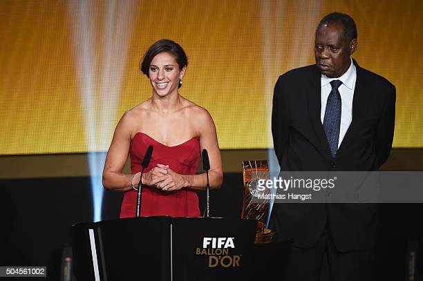 Carli Lloyd of USA and Houston Dash receives the during the FIFA Women's World Player of the Year Award from Acting FIFA President Issa Hayatou FIFA...