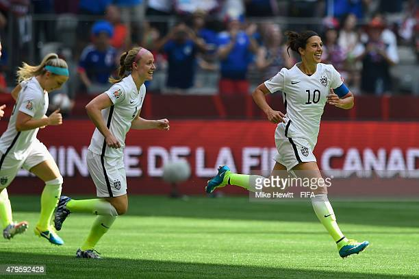 Carli Lloyd of USA celebrates after scoring her second goal during FIFA Women's World Cup 2015 Final between USA and Japan at BC Place Stadium on...