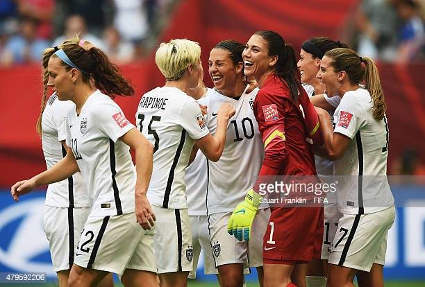 Carli Lloyd of USA celebrates scoring her third goal with teamates during the FIFA Women's World Cup Final between USA and Japan at BC Place Stadium...