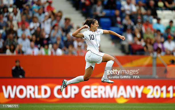 Carli Lloyd of USA celebrates scoring the third goal during the FIFA Women's World Cup 2011 Group C match between USA and Columbia at the Rhein...