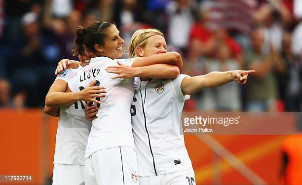 Carli Lloyd of USA celebrates with her team mates after scoring her team's third goal during the FIFA Women's World Cup 2011 Group C match between...
