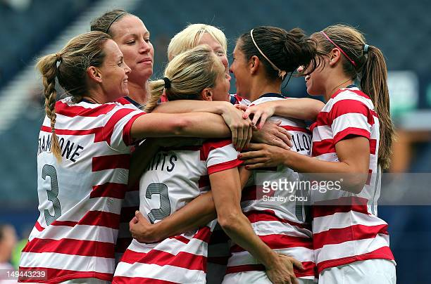 Carli Lloyd of USA celebrates with her teammates after scoring their third goal during the Women's Football first round Group G match between United...