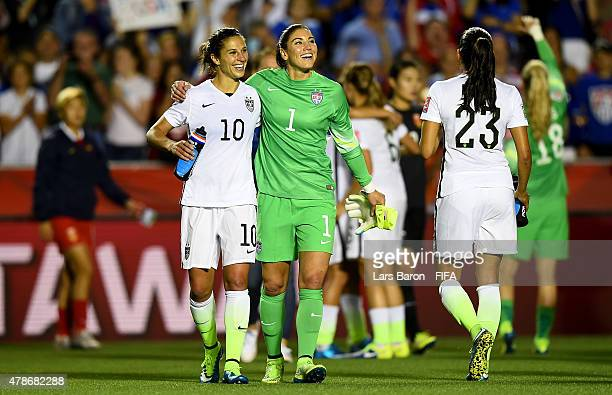 Carli Lloyd of USA celebrates with Hope Solo of USA after winning the FIFA Women's World Cup 2015 Quarter Final match between China and United States...
