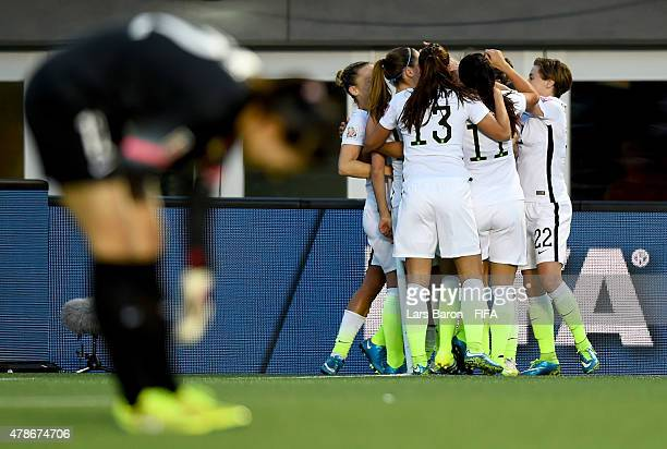 Carli Lloyd of USA celebrates with team mates after scoring her teams first goal during the FIFA Women's World Cup 2015 Quarter Final match between...