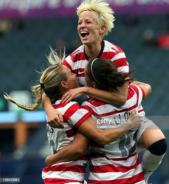 Carli Lloyd of USA celebrates with teammates Megan Rapinoe and Alex Morgan after scoring their third goal during the Women's Football first round...