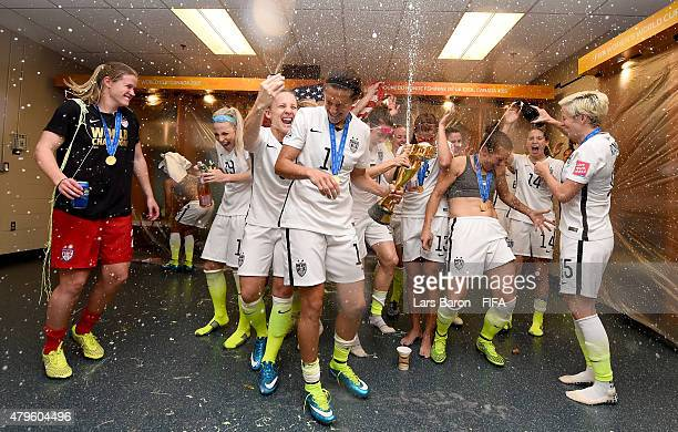 Carli Lloyd of USA celebrates with the trophy and her team mates in the locker room after winning the FIFA Women's World Cup 2015 Final between USA...