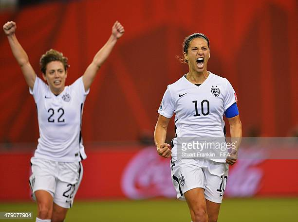 Carli Lloyd of USA clebrates scoring her penalty goal during the FIFA Women's World Cup Semi Final match between USA and Germany at Olympic Stadium...