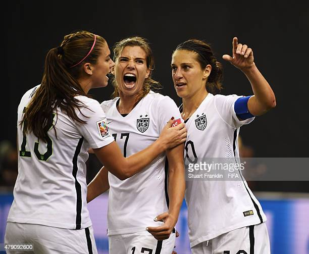 Carli Lloyd of USA clebrates scoring her penalty goal with Tobin Heath during the FIFA Women's World Cup Semi Final match between USA and Germany at...