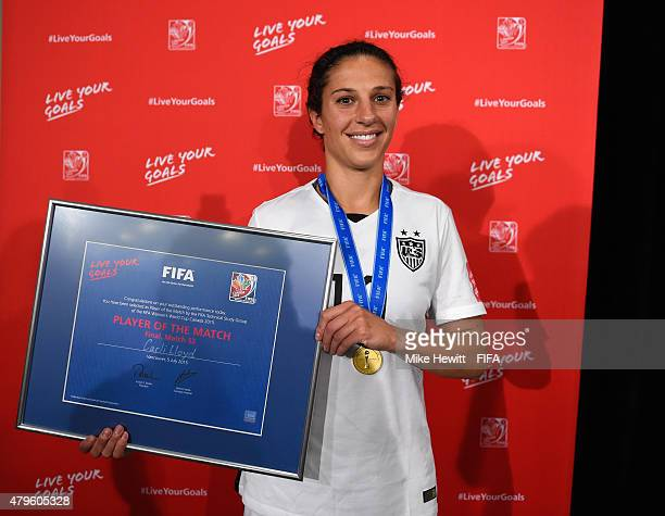 Carli Lloyd of USA receives her Player of the Match award during FIFA Women's World Cup 2015 Final between USA and Japan at BC Place Stadium on July...