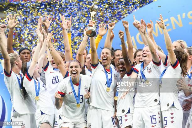 Carli Lloyd of USA rise up the trophy during award ceremony of the 2019 FIFA Women's World Cup France Final match between The United State of America...
